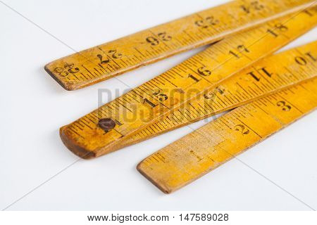 Retro wooden carpenter ruler measure. measuring tools. square shape. white background.