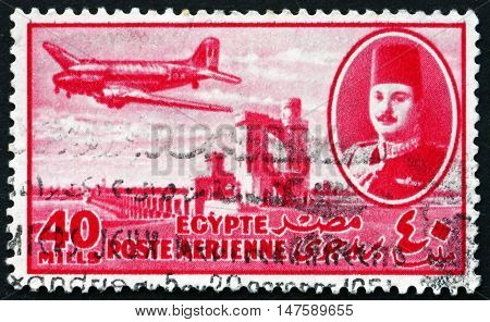 EGYPT - CIRCA 1947: a stamp printed in Egypt shows King Farouk Delta Dam and DC-3 Plane circa 1947