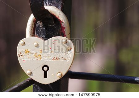 Vintage lock macro view. Security concept with closed silver padlock. soft focus, shallow depth of field