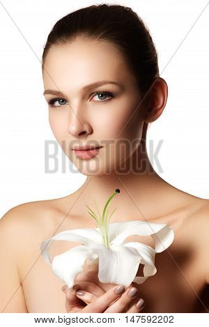 Pretty Face Of Beautiful Young Woman With Lily On Hands - White