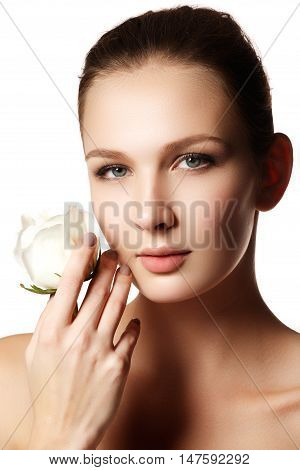 Pretty Face Of Beautiful Young Woman With Rose On Hands - White