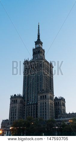 Warsaw, Poland. City center with Palace of Culture and Science, a landmark and symbol of Stalinism and communism, and modern sky scrapers.