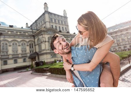 My dear. Portrait of a delighted and merry young couple having fun in the city