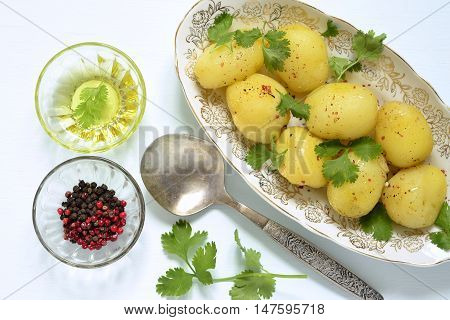 Young boiled potatoes with cilantro,  top view