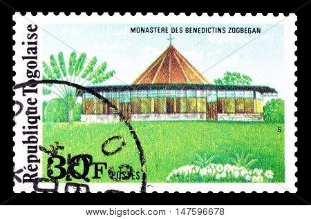 TOGO - CIRCA 1975 : Cancelled postage stamp printed by Togo, that shows Monastery Zogbegan.