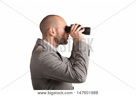 Elegant business man looking carefully through binoculars