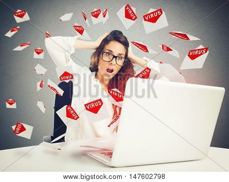 Desperate businesswoman looks at the letters that come from the computer