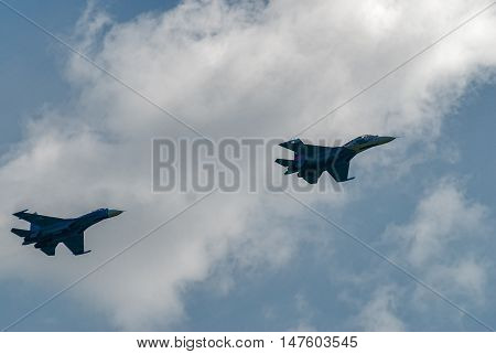 Nizhniy Tagil, Russia - July 12. 2008: Russian fighters SU-27 knight put bend. Display of fighting opportunities of equipment with application of aviation means of defeat. RAE exhibition