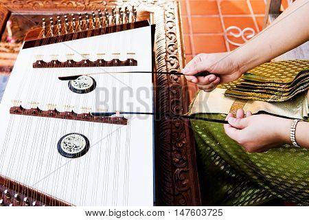 hand play dulcimer, music instrument,Thai wooden dulcimer musical instrument
