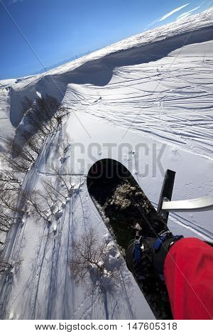 Snowboard Over Off-piste Slope In Sun Day