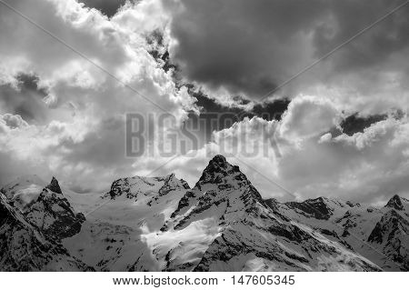 Black And White View On Evening Mountains In Sunlight Clouds