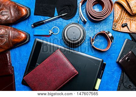 Photographer equipment and accessories over blue background. Flat lay. Color toning