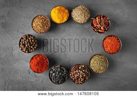 Different spices in bowls on table