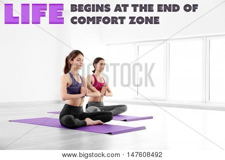 Comfort zone concept. Young women doing yoga in gym