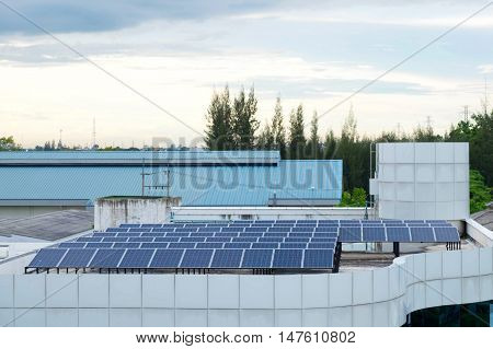 Solar panel system on building roof in factory