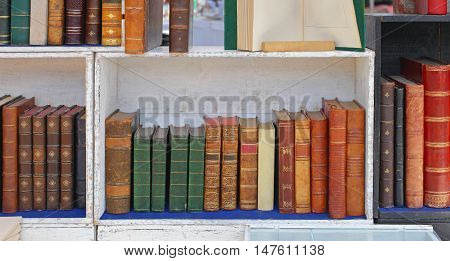 Rare Books in Wooden Bookcase at antique Market