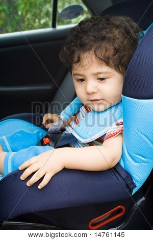 toddler boy sitting in car seat