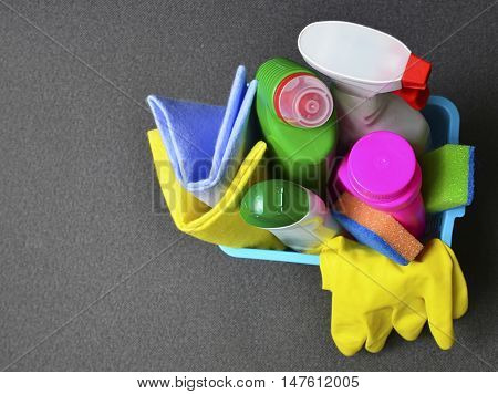 House cleaning product in blue basket.Cleaning equipment.Top view.