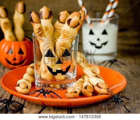 Halloween witch's fingers cookies. Homemade cookies in the form of terrible human fingers decoration almond nail for treat kids for Halloween party selective focus