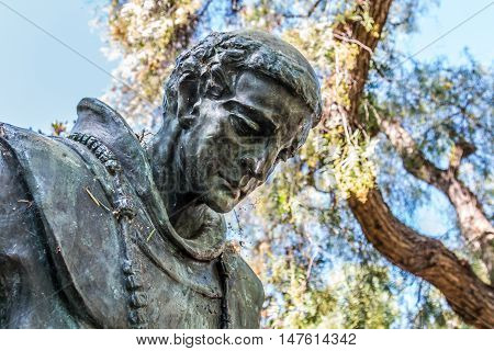 SAN DIEGO, CALIFORNIA - AUGUST 13, 2016: Bowed head of statue of Father Junipero Serra at the Serra Mission Museum, the former site of a fort and the first European settlement on the Pacific Coast.