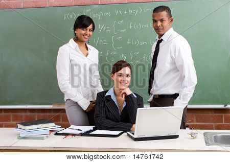 group of young school teachers in classroom