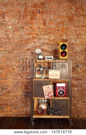 Retro studio with brick wall, shelves with radio, fan, helmet