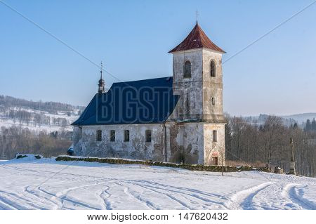 The old church in a snowy landscape