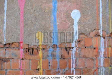 abstract paint drips on concrete wall after paintball playing