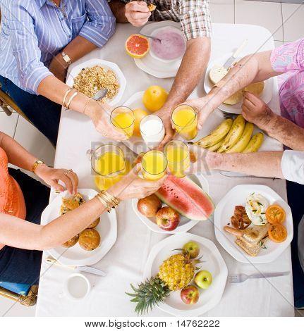 overhead view of group of people having breakfast