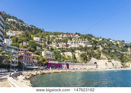 Summer coastline and beach in Villefranche-sur-Mer luxury resort near City of Nice Cote d'Azur France