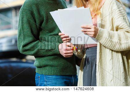 Couple Standing Holding Paper Keys.