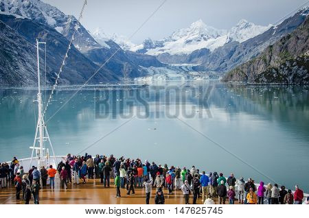 GLACIER BAY - ALASKA SEPTEMBER 11, 2016: Cruise ship passengers get a close-up view of the majestic glaciers as they sail in Glacier Bay National Park and Preserve in Southeast Alaska, one of the world's largest protected natural areas.