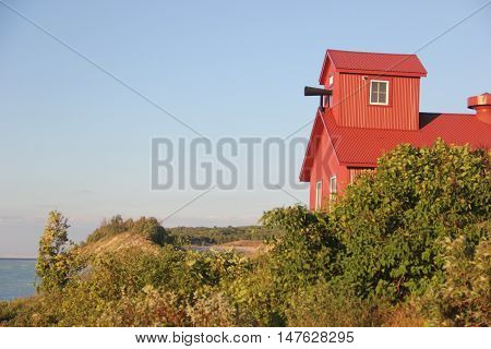 The Point Betsie Lighthouse's Foghorn with dunes in the background.  Michigan