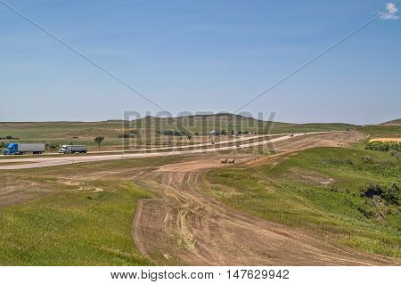 Interstate in eastern Montana with tractor trailers and other vehicles traveling through rural Big Sky Country
