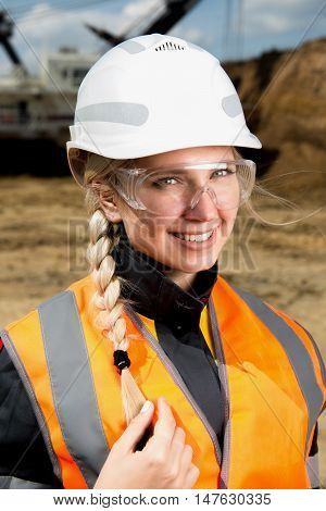 Woman working on a project in an open pit