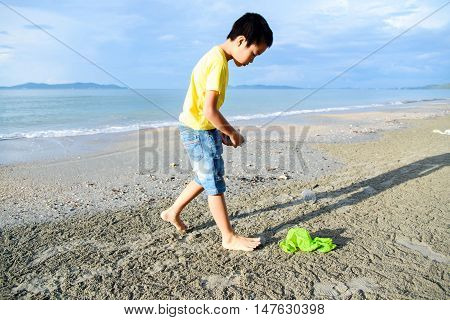 Boys Collecting Garbage From The Beach