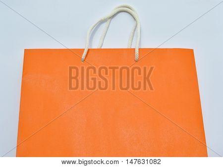 orange paper bag and white nylon rope handle