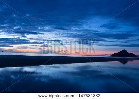 Hua Hin Prachuap Khiri Khan Thailand - September 012015: Beautiful sunrise at the beach amazing colors light beam shining through the cloudscape over Thai gulf seascape Hua Hin Prachuap Khiri Khan Thailand.