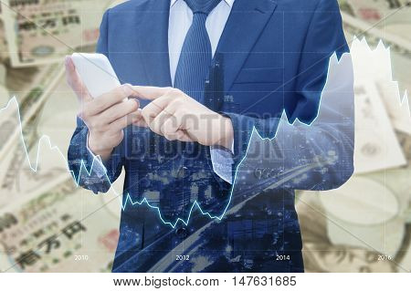 Double Exposure Of Businessman , Financial Graph And Cityscape With Japanese Jpy Yen Bank Note Pile