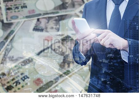 Double Exposure Of Businessman Using Smart Phone And City Of Business With Japanese Jpy Yen Bank Not