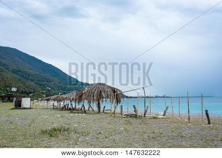 Deserted beach in Gagra Abkhazia in cloudy autumn day.