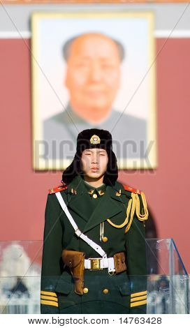 BEIJING, CHINA - DECEMBER 17: A paramilitary police officer guards Tian'anmen square on December 17, 2009 in Beijing, China.