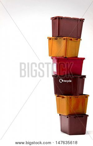 Stack of plastic crates isolated over white background