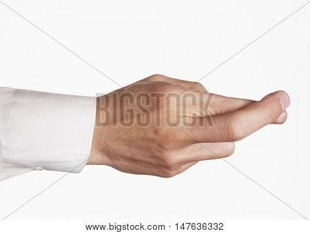 Closeup of hand with fingers crossed against white background
