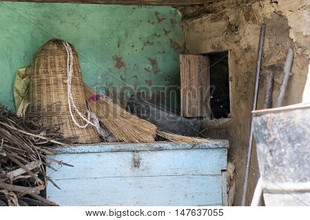Ground floor of a traditional house used for storing items, fire wood stick etc. in a rural village of Himachal Pradesh, India.