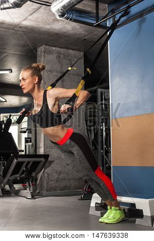 Sport Girl Is Engaged In Exercises Trx