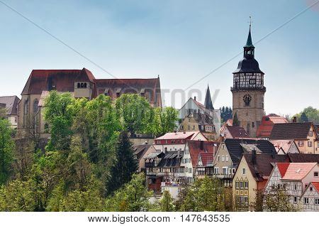 Landmarks of Backnang Baden-Wurttemberg Germany. Panoramic view of the trees half-timbered houses and a church.