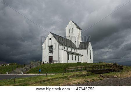 Large Icelandic cathedral in Skalholt against a overcast sky