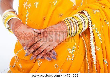 Indian wedding bride hands with henna