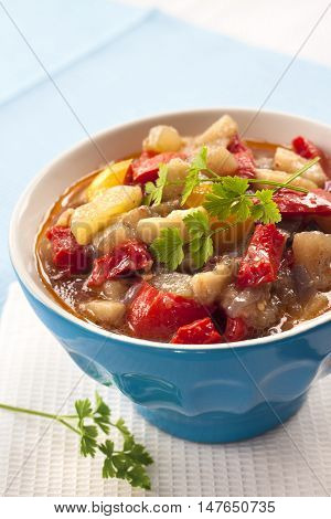 Colorful vegetable stew in a blue bowl